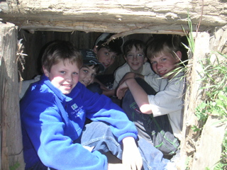 Boys in small shelter